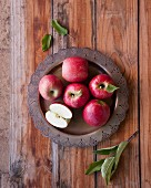 Red apples on a metal plate (seen from above)