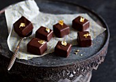 Dark chocolate bite with gold leaf