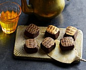 Date and marzipan pralines with chilli and saffron