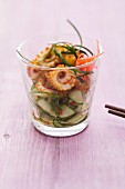 Chilli baked squid with a lime and cucumber salad in a glass
