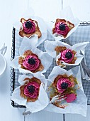 Blackberry cupcakes on a wire rack