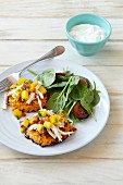 Sweet potato cakes with chicken and mango salsa, salad and a dip