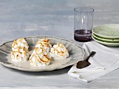 Homemade meringues on a grey plate