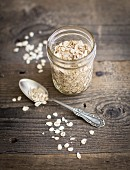 Oats in a screw top jar and on a silver spoon