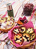 Wraps, blackberry-muffins, vegetable chips and grapes