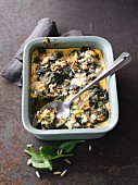 Spinach and polenta bake with sheep's cheese and pine nuts