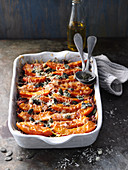 Pumpkin and minced meat lasagne with Parmesan cheese and pumpkin seeds