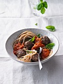 Pasta with feta cheese meatballs and oven-roasted tomato sauce