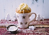 A Christmas mug cake with gingerbread spice and sultanas