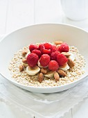 Wholemeal oats with bananas, raspberries, almonds and honey