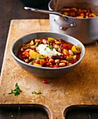 Spicy lentil and bean stew with tomatoes and sour cream