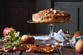 Apple cake with dried apple rings on a cake stand