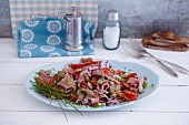 Quick roast beef salad with peppers and pumpkin seed oil