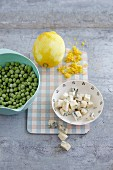 Ingredients for lemon risotto with peas and gorgonzola