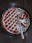 Linzer tart, a piece cut