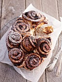 Poppy seed buns with plum jam and icing sugar