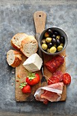 Antipasti on a wooden board