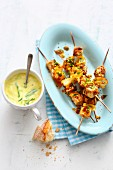 Vegetarian tofu and lemon skewers with a yoghurt and cucumber dip