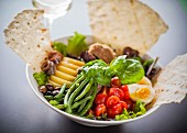Mixed leaf salad with egg and unleavened bread