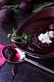 Beetroot soup in a soup bowl with crème fraîche
