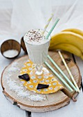 A coconut and banana smoothie in a sundae glass