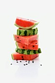 A stack of watermelon slices with seeds