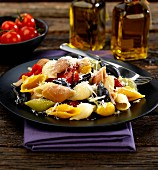 Shell pasta with grilled peppers, tomatoes and Parmesan cheese