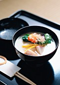 Mochi soup with vegetables for New Year (Japan)