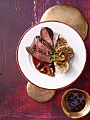 Fillet of venison with a blueberry sauce and chanterelle mushroom dumplings