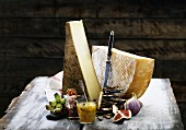Two large slices of hard cheese with crispbreads and chutney on a rustic wooden table