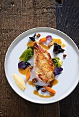 Roast pheasant breast with vegetables and wild mushrooms