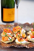 Salmon canapés served with champagne