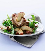Pork fillet with steamed apples, bacon and rocket