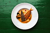 Bouillabaisse with fish, vegetables and mussels