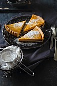 Sweet pumpkin tart with chocolate cream and icing sugar
