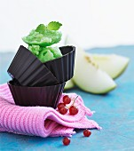Melon sorbet in chocolate cases