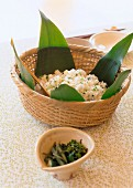 Rice with rapeseed in a bamboo basket