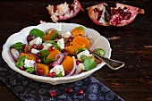 Pumpkin salad with feta cheese and pomegranate seeds