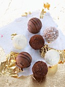 Various white and dark chocolate pralines with gold foil