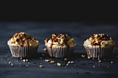 Cupcakes with caramel cream and chopped nuts