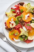 Exotic fruit salad with grated coconut and mint