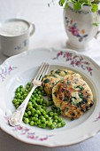 Potato and spinach burgers with feta cheese, peas and yoghurt