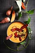 Sweet potato soup with glazed bacon