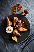 Pears roasted in honey and whiskey with pepper brittle