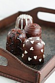 Chocolate marshmallows decorated with icing