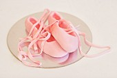 Cake decoration: ballet slippers made from icing