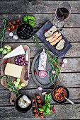 Various Italian antipasti on a wooden table (seen from above)