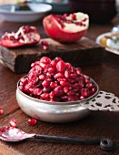 Cranberry and pomegranate relish in a silver bowl on a wooden table