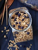 A jar of homemade muesli with blueberries