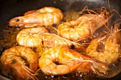 Prawns sizzling in a pan (close-up)